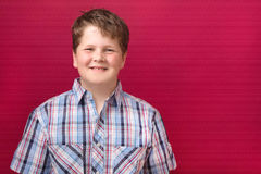 Happy boy on red background. On red background a happy boy Royalty Free Stock Images