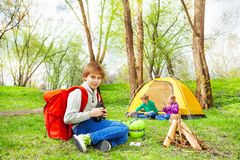 Happy boy with red backpack holds binocular Stock Photo