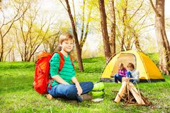 Happy boy with red backpack resting at camp Stock Photo