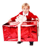 Happy boy with red gift box. Isolated Royalty Free Stock Photo
