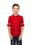 Happy boy in red shirt Stock Photos