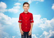 Happy boy in red shirt over blue sky Stock Photography
