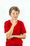 Happy boy with red shirt thinks Royalty Free Stock Image