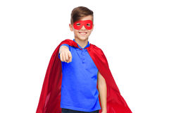 Happy boy in red superhero cape and mask Royalty Free Stock Photo
