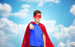 Happy boy in red superhero cape and mask Royalty Free Stock Photography