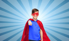 Happy boy in red superhero cape and mask Stock Photos