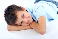 Happy boy relaxing on ground. Portrait of happy boy relaxing on ground Stock Images