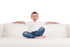 Happy boy relaxing on sofa Royalty Free Stock Photography