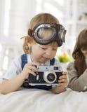 Happy boy with retro camera Royalty Free Stock Photo