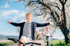 Happy boy ride on bicycle with his father Royalty Free Stock Photos