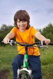 Happy boy ride bikes outdoors Royalty Free Stock Photo