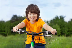 Happy boy ride bikes outdoors Stock Photo