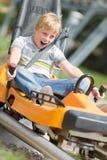 Happy Boy Riding At Bobsled Coaster Rail Trac Royalty Free Stock Photography