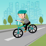 Happy Boy Riding on Bicycle in the City. Vector Stock Images