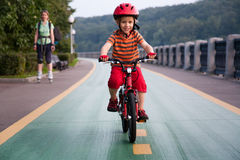 Happy boy riding a bicycle. Royalty Free Stock Images