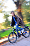 Happy boy riding bike Stock Images