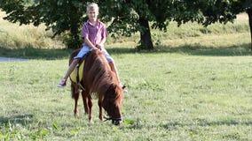 Happy boy riding pony stock video footage