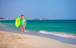 Happy boy running the beach, expressing delight Royalty Free Stock Images