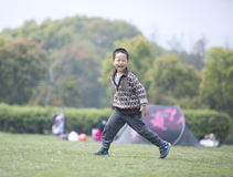 Happy boy running on the grass Royalty Free Stock Photos