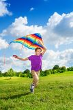 Happy boy running with kite Royalty Free Stock Image