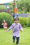 Happy boy running in the park Stock Photography