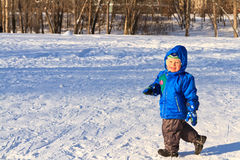 Happy boy running in snow Stock Images