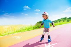 Happy boy rushing downhill on rollerblades Royalty Free Stock Photos