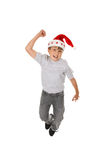 Happy boy in Santa hat Stock Photo