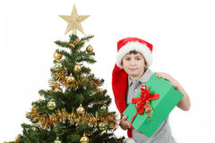 Happy boy in santa hat show christmas present Royalty Free Stock Photography