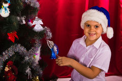 Happy boy in Santa's hat Royalty Free Stock Images