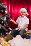 Happy boy in Santa's hat Royalty Free Stock Photography