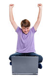 Happy boy sat with laptop isolated Stock Photography