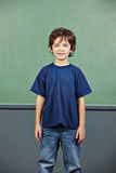 Happy boy in school Stock Images