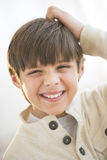 Happy Boy Scratching Head At Home Stock Photos