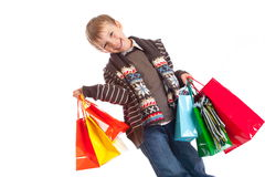 Happy Boy with Shopping Bags stock photos