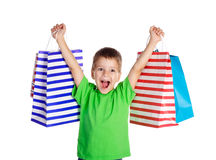 Happy boy with shopping bags Stock Photo