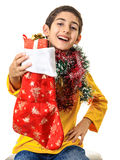Happy boy showing Christmas gift Stock Image