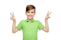 Happy boy showing peace or victory hand sign Stock Photography