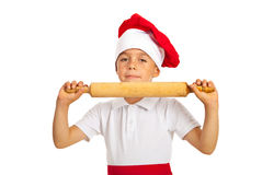 Happy boy showing rolling pin Royalty Free Stock Image