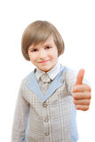 Happy boy is showing thumb up gesture. Isolated on white background Royalty Free Stock Photo