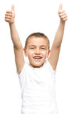 Happy boy is showing thumb up gesture. Using both hands, isolated over white Stock Photo