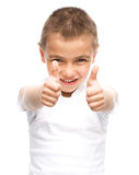 Happy boy is showing thumb up gesture. Using both hands, isolated over white Royalty Free Stock Photo
