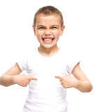 Happy boy is showing thumb up gesture. Using both hands, isolated over white Royalty Free Stock Image