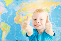 Happy boy showing thumbs up Royalty Free Stock Image