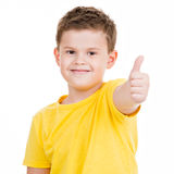 Happy boy showing thumbs up gesture. Isoated on white Stock Images