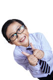 Happy boy showing thumbs up gesture. Portrait of happy boy showing thumbs up gesture, isolated over white background Royalty Free Stock Images