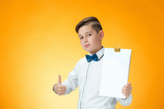 Happy boy showing thumbs up sign OK Stock Images