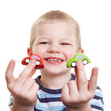 Happy boy showing toy cars Royalty Free Stock Photography