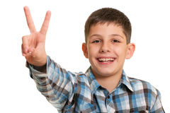Happy boy showing a victory sign Royalty Free Stock Photography