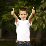 Happy boy shows thumbs up Stock Photo